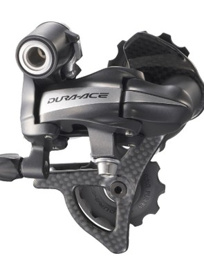 The rear derailleur features a carbon fiber pulley cage and a composite knuckle for lighter weight.
