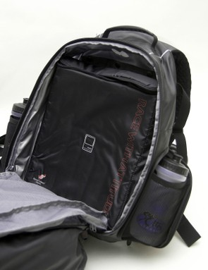 An optional snap-in padded laptop sleeve fits in the rear compartment.