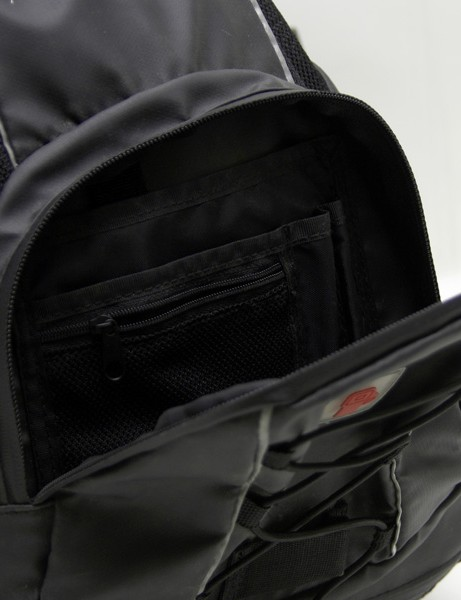 The outside organizer panel provides a handy place for pens, cameras, or other gear.