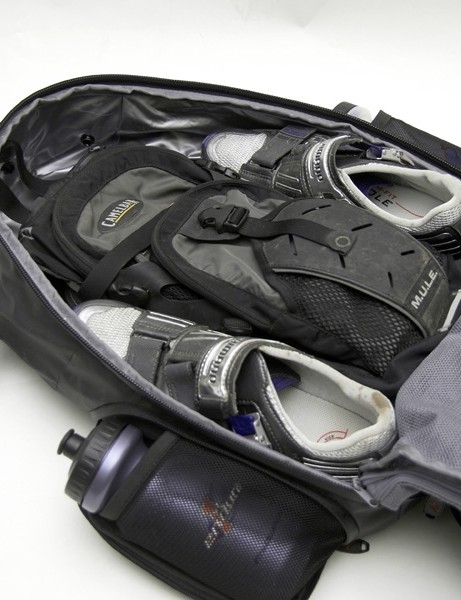 The rear half of the bag holds larger items…