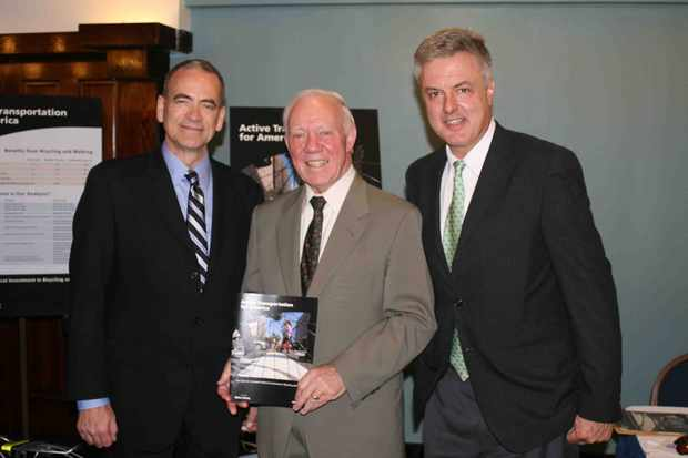 RTC's Keith Laughlin, Rep. James Oberstar (C) holding the report, and Bikes Belong's Tim Blumenthal.