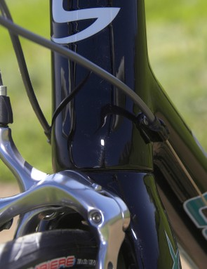 Cable stops are neatly riveted at the base of the head tube.