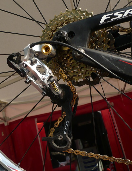 A SRAM X.0 rear derailleur is mated to an ultralight KMC chain and a TiN-coated cassette.