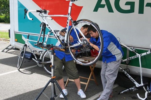 The Shimano guys inspect the way their new components fit to one of the Crédit Agricole team Looks