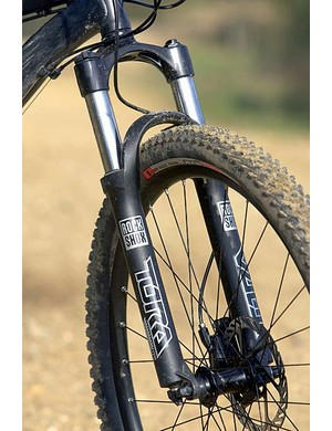 The RockShox Tora fork is controlled, if not super comfy.