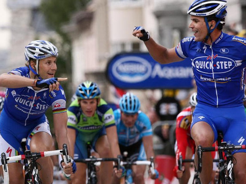 Tom Boonen (L) congratulates his Quick.Step teammate Gert Steegmans on his victory in the second sta