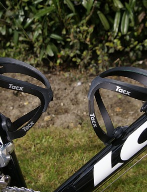 Tacx Tao cages look like they're a solid loop of aluminum but they spring open in the middle.