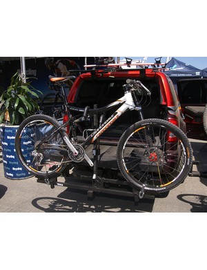 The Thule Doubletrack hitch-mounted carrier has much of the functionality but is cheaper than the T2
