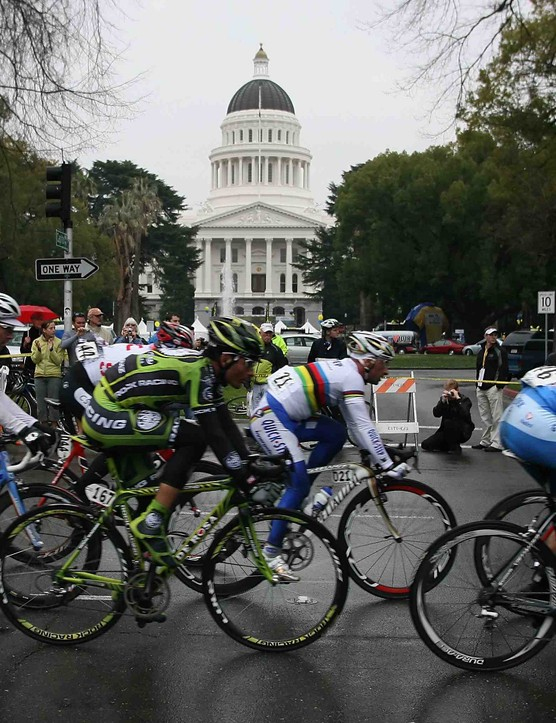 The 2008 Tour of California peloton flies past the state capitol building this past February.