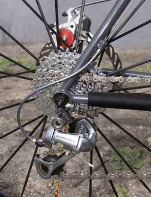 The road shifters naturally require the use of the corresponding road rear derailleur.