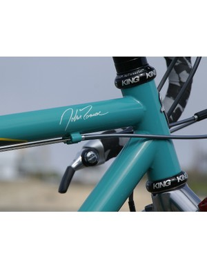 The only branding on the bike is Tomac's signature on the top tube and the usual head tube badge.