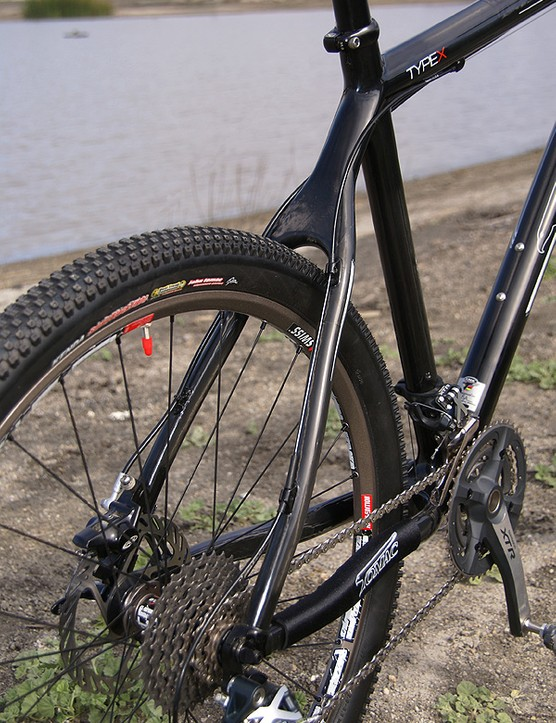 The carbon rear end features a clean-looking wishbone-style seat stay assembly and short chain stays