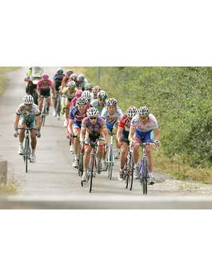 Britain's Tony Gibb (Plowman Craven - Evans Cycles) (right) leads the fifteen man breakaway group at