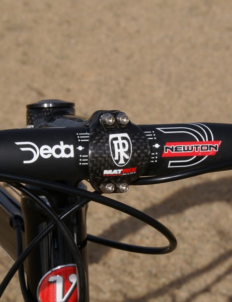 We went with an aluminum Deda Newton 31.8 handlebar and aluminum-cored Ritchey WCS Carbon 4-Axis stem for durability.