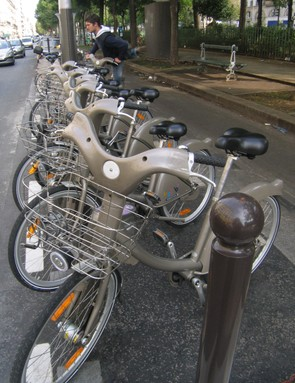 Velib bikes in use on the streets of Paris
