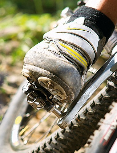 Drop the outside pedal in corners and put as much weight as possible on that foot.
