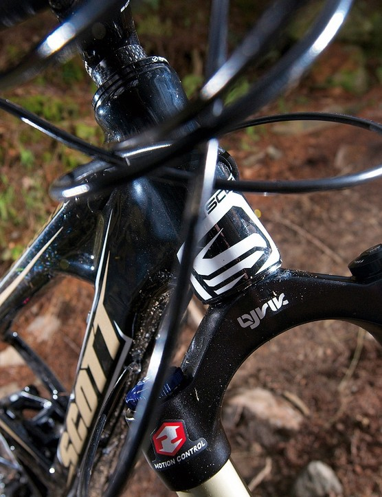 Lots of carbon in the head tube houses the superb Lyrik fork
