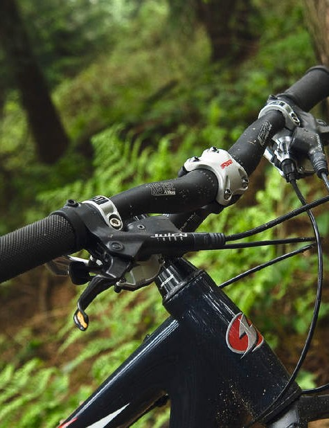 Cockpit and ride position feel trail-friendly for a race bike