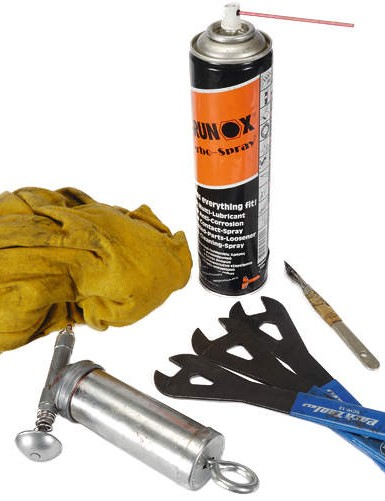 Lint free rag, scalpel, grease (with gun), cone spanners, degreaser (with straw nozzle).