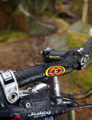 The wide bars and short stem hint at hardcore attitude