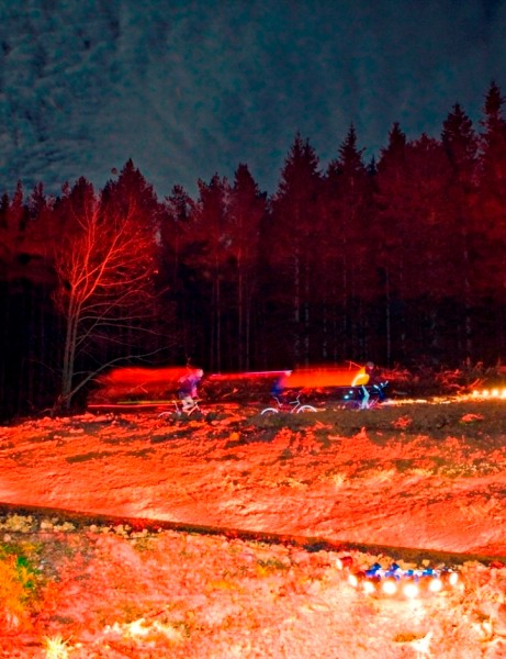 Cyclists enjoying the illuminated route through Kielder Forest and Lakeside Way