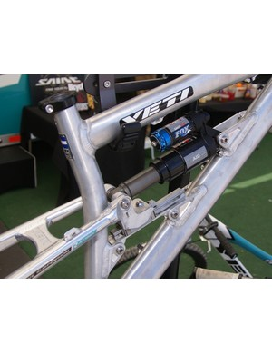The Fox Racing Shox DHX Air rear shock is controlled by the linear motion rail.