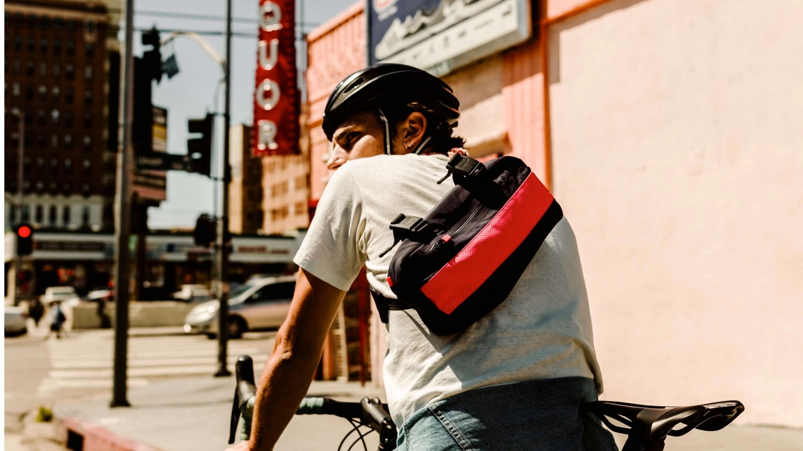 Rapha is calling this handlebar bag a Mini Messenger Bag because you can also wear it like this