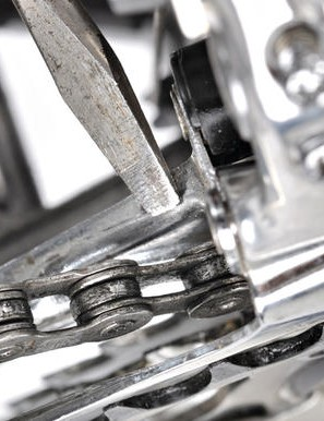 3 Chain rubs on derailleur cage on middle chainwheel of a triple