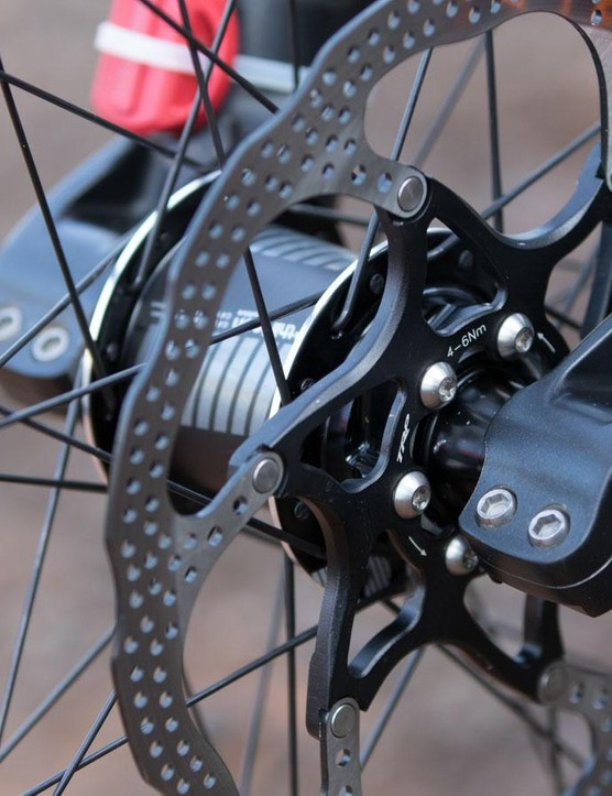 TRP has its own two-piece rotors. Note the carbon-shelled e*thirteen hub
