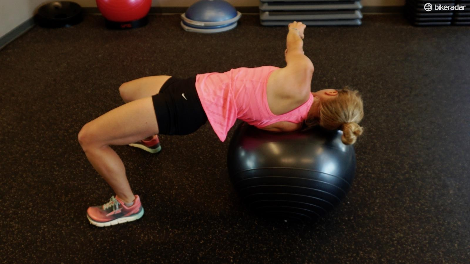 """The supine twist is an abdominal and glute """"super"""" exercise — keep those hips up and use additional weight or speed for increasing difficulty"""