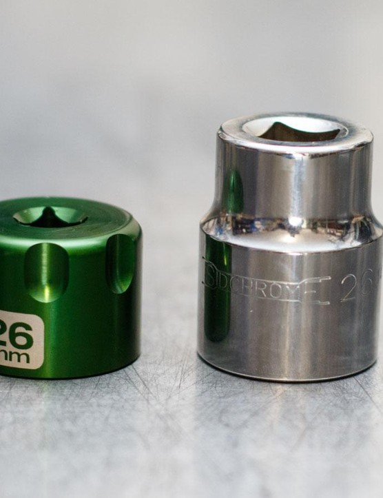 An Abbey Bike Tools suspension top cap socket next to an average depth automotive socket. The shallower Abbey is far less likely (and harder) to cam off a shallow top cap