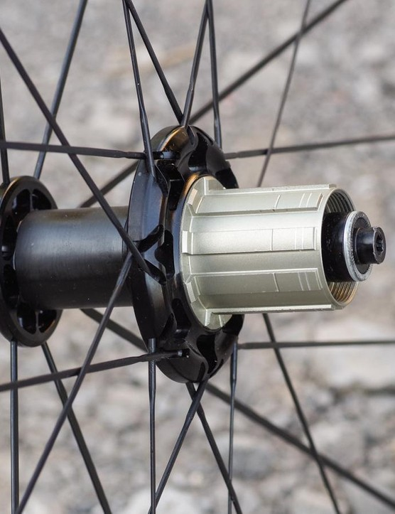 Triplet lacing and an offset rear rim aim to produce a strong, durable wheel