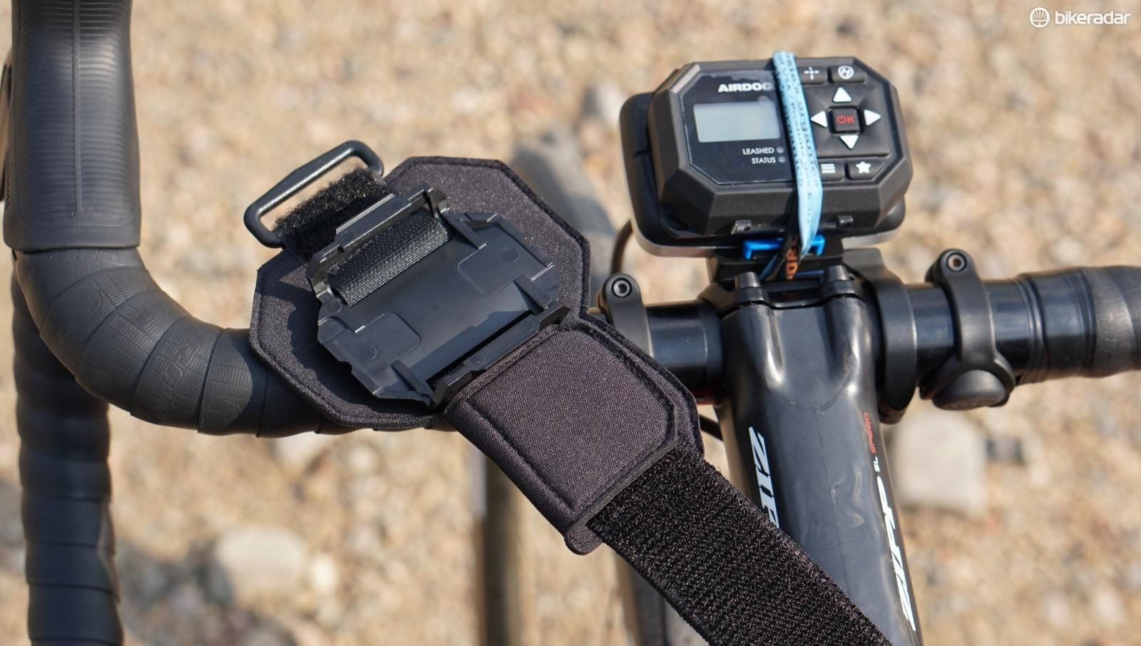 The Leash comes with this arm/wrist band, which isn't ideal for riding bikes