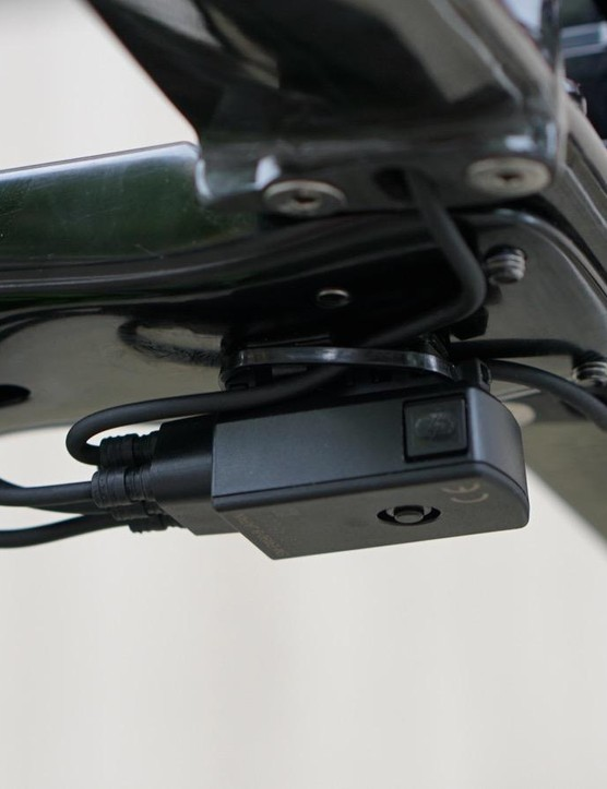 Shimano's Di2 junction box zip-tied in place