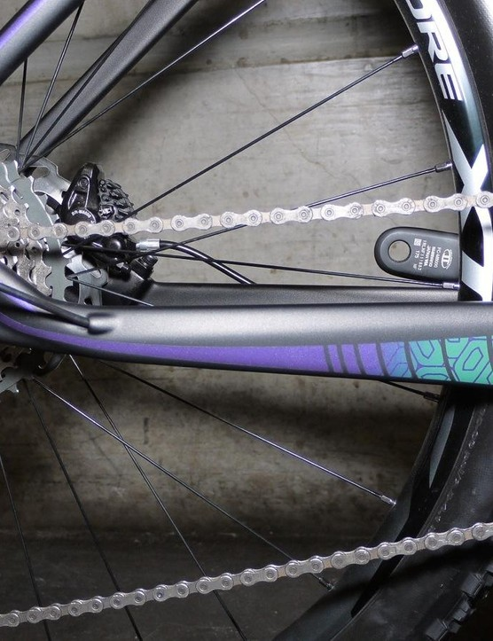 The entire frame is coated in wet paint, with purple and turquoise accents dotting the entire bike
