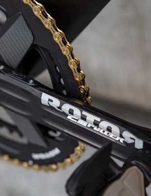The drivetrain uses a KMC gold chain