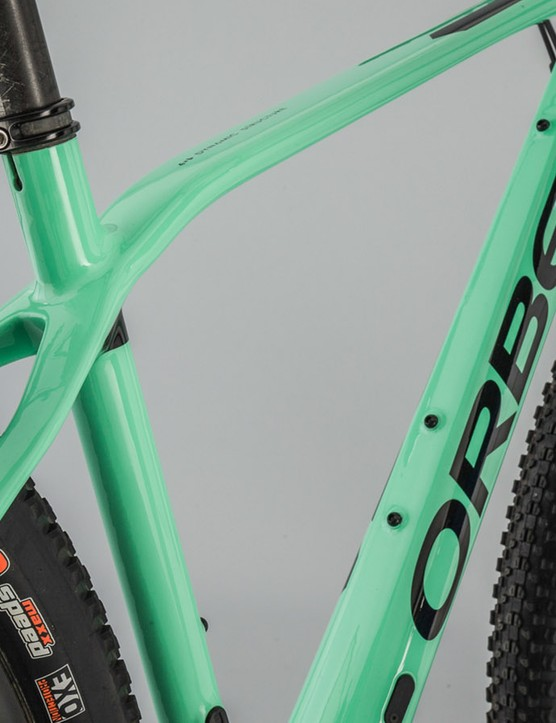 You can see the bump on the top tube in front of the seatpost, Orbea says it promotes vertical compliance