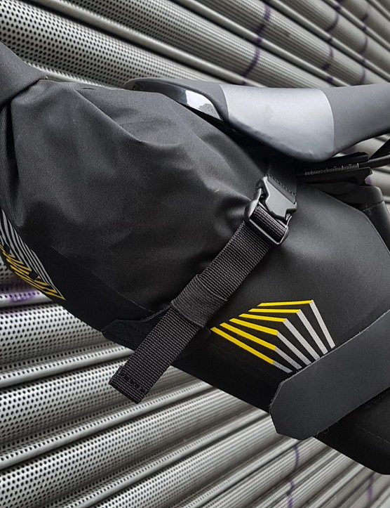 The small seat pack is waterproof and sits securely under the saddle