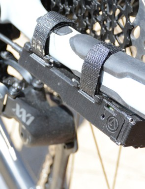It attaches under the driveside chainstay — attachment is currently with Velcro but may change by final production