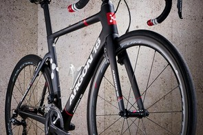 The front brake tucks neatly behind the fork