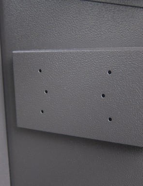 There are mounting plates for electrical sockets at either end of the box