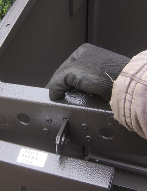 The front upper corners are reinforced with these braces, which also hold the shackles to which the lid is locked