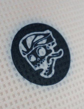 Attaquer's flying skull logo adorns the chest of the jersey