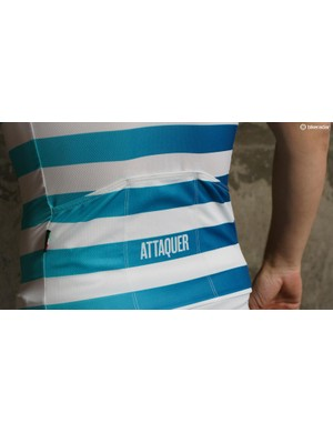 The teal stripes fade as they wrap across the torso