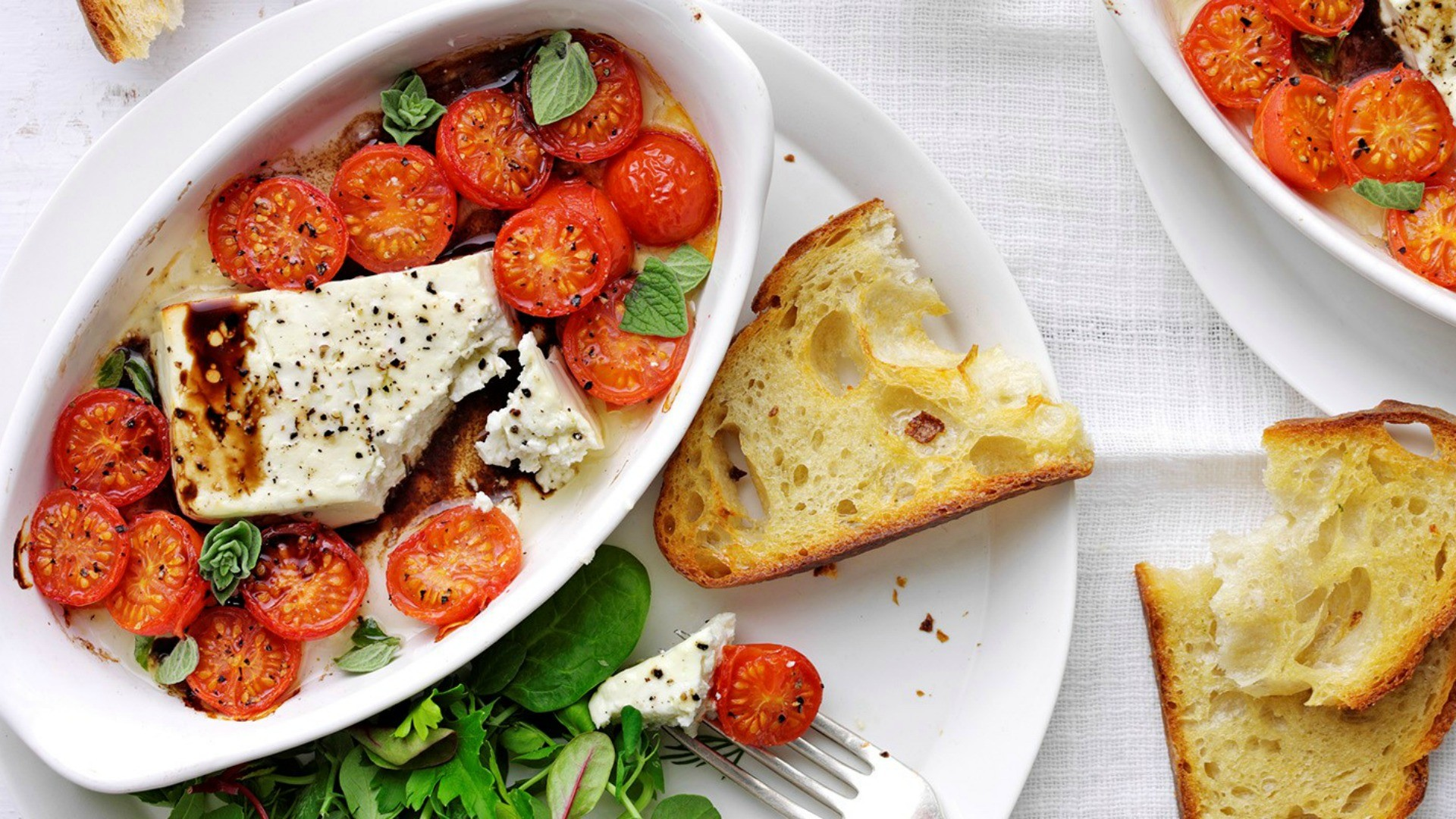 Warm creamy feta compliments the freshness of roasted tomatoes and the crunch of garlic bread