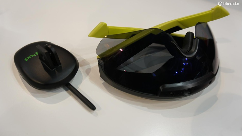 The PowerPod, at left, mounts under a bike computer and measures environmental conditions