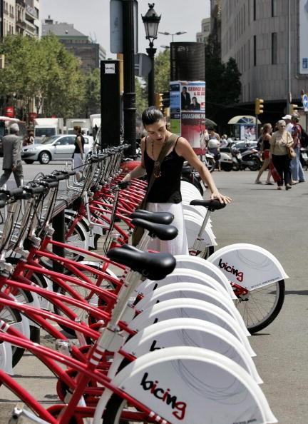 A rider helps herself to a free bike in Barcelona