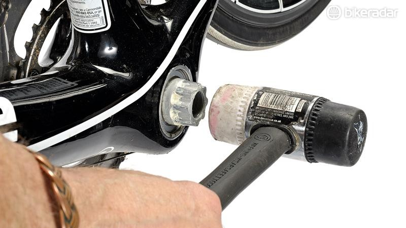 Gently tap the cranks with a rubber faced mallet to remove them