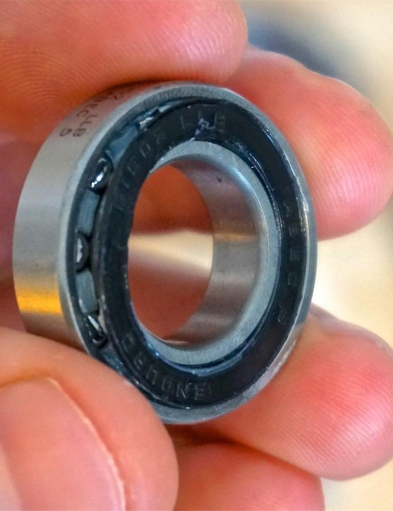 Seals on cartridge bearings can be carefully removed to clean and inject fresh grease, but be warned, this can lead to a ruined bearing if done incorrectly