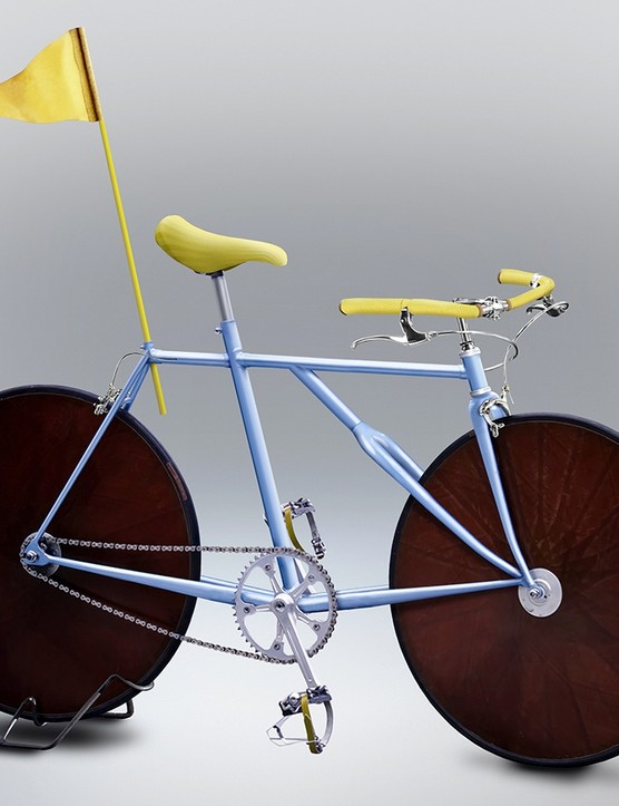 Disc wheels? Check. Super-high track gearing? Check. Jaunty yellow flag? Check.